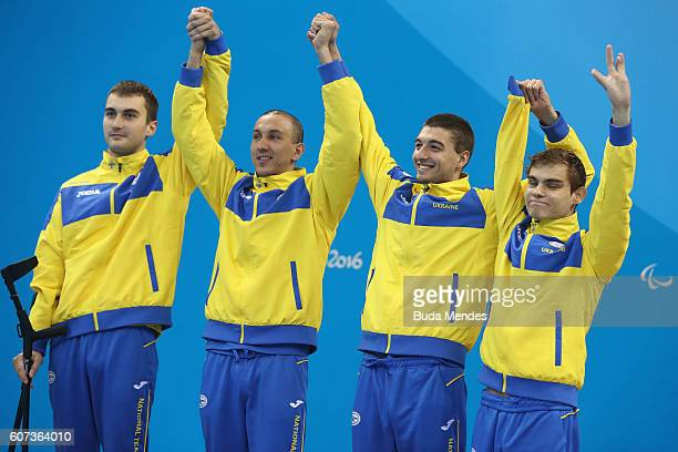 Silver medalists Ukraine celebrate on the podium at the medal ceremony for the Men's 4x100m Medley Relay 34 Points on day 10 of the Rio 2016...