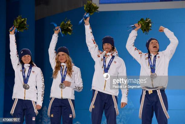 Silver medalists Veronika Vitkova, Gabriela Soukalova, Jaroslav Soukup and Ondrej Moravec of the Czech Republic celebrate during the medal ceremony...