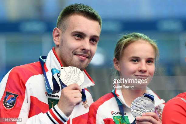 Silver medalists Viktor Minibaev and Ekaterina Beliaeva of Russia pose during the medal ceremony for the Mixed 10m Synchro Platform Final on day two...