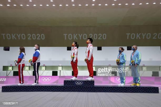 Silver Medalists Vitalina Batsarashkina and Artem Chernousov of Team ROC, Gold Medalists Ranxin Jiang and Wei Pang of Team China, and Bronze...