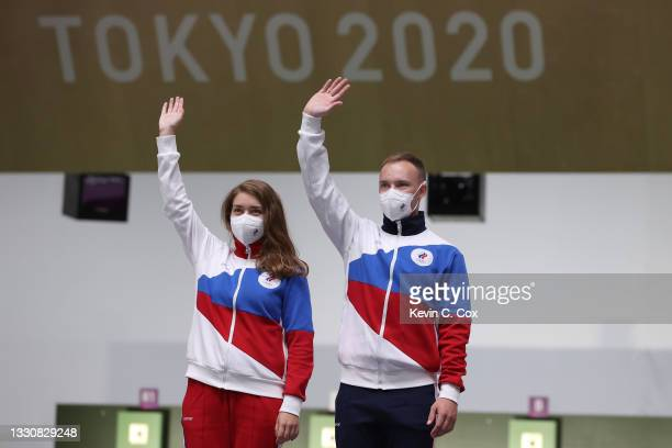 Silver Medalists Vitalina Batsarashkina and Artem Chernousov of Team ROC pose during the medal ceremony following the 10m Air Pistol Mixed Team event...