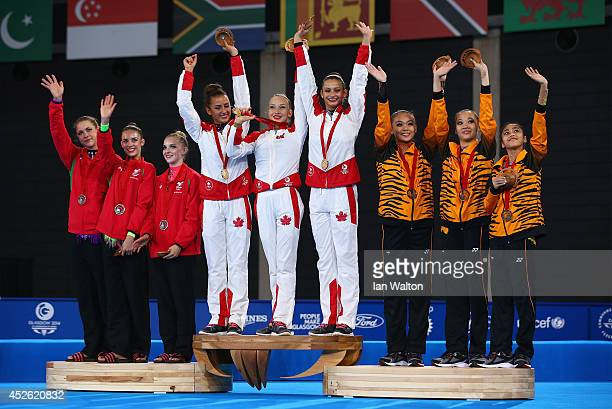 Silver medalists Wales, gold medalists Canada and Bronze medalists Malaysia pose on the podium during the medal ceremony Rhythmic Gymnastics Team...