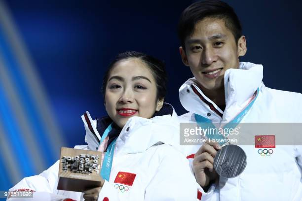 Silver medalists Wenjing Sui and Cong Han of China celebrate during the medal ceremony for the Pair Skating Free Skating on day six of the...