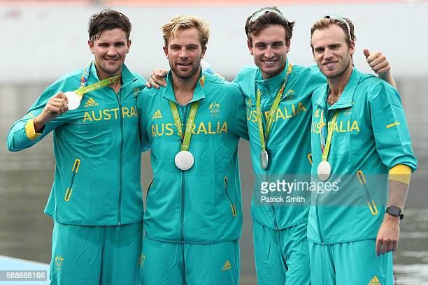 Silver medalists William Lockwood Joshua DunkleySmith Joshua Booth and Alexander Hill of Australia pose for photographs on the podium at the medal...