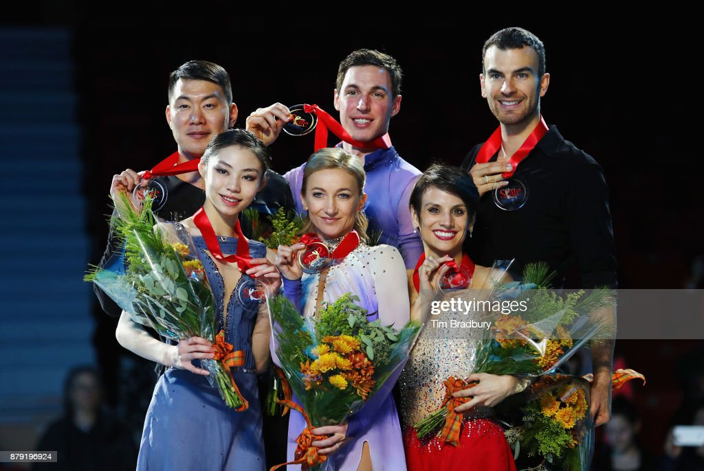 Silver medalists Xiaoyu Yu and Hao Zhang of China, gold medalists Aliona Savchenko and Bruno Massot of Germany, and bronze medalists Meagan Duhamel and Eric Radford of Canada pose after competing in the Pairs Free Skating during day two of 2017 Bridgestone Skate America at Herb Brooks Arena on November 25, 2017 in Lake Placid, New York.