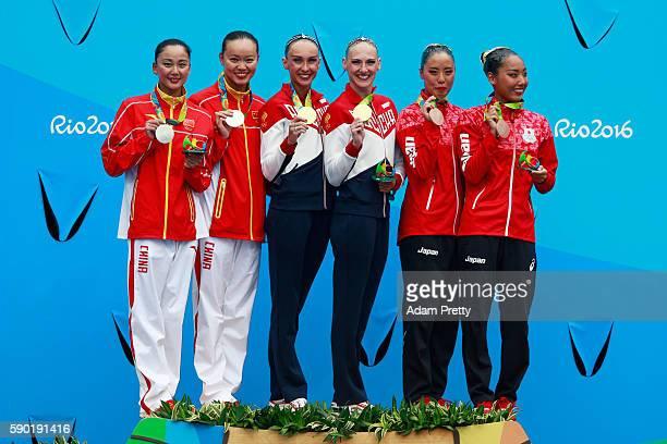 Silver medalists Xuechen Huang and Wenyan Sun of China gold medalists Natalia Ishchenko and Svetlana Romashina of Russia and bronze medalists Yukiko...