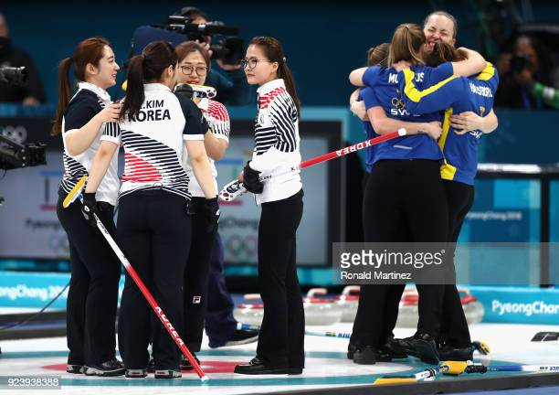 Silver medalists YeongMi Kim SeonYeong Kim KyeongAe Kim and EunJung Kim of Korea reacts as gold medalists Sweden celebtrate during the Women's Gold...