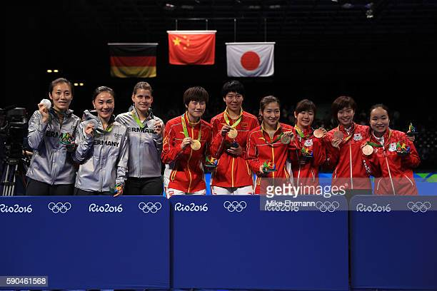 Silver medalists Ying Han Xiaona Shan and Petrissa Solja of Germany Gold medalists Ning Ding Xiaoxia Li and Shiwen Liu of China and Bronze medalists...