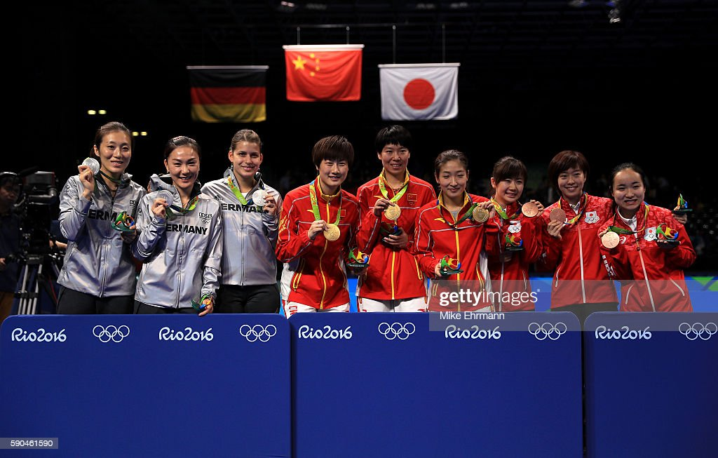 Silver medalists Ying Han, Xiaona Shan and Petrissa Solja of Germany, Gold medalists Ning Ding, Xiaoxia Li and Shiwen Liu of China and Bronze medalists Mima Ito, Kasumi Ishikawa and Ai Fukuhara of Japan pose on the podium during the medal ceremony for the Women's Team Match between China and Germany on Day 11 of the Rio 2016 Olympic Games at Riocentro - Pavilion 3 on August 16, 2016 in Rio de Janeiro, Brazil.