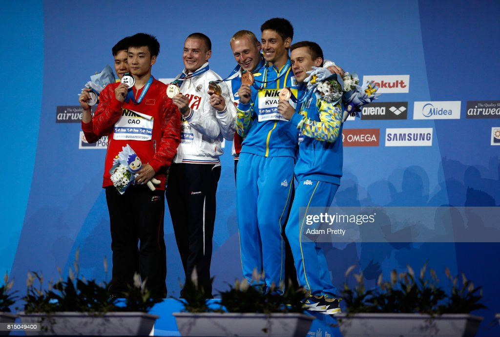 Silver medalists Yuan Cao and Siyi Xie of China gold medalists Evgenii Kuznetsov and Ilia Zakharov of Russia and bronze medalists Oleg Kolodiy and Illya Kvasha of Ukraine pose with their medals following the Men's Diving 3m Sychro Springboard Final on day two of the Budapest 2017 FINA World Championships on July 15, 2017 in Budapest, Hungary.
