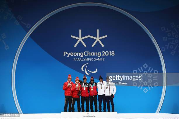 Silver medalists Yury Holub and his guide Dzmitry Budzilovich of Belarus Gold medalists Brian McKeever and his guide Graham Nishikawa of Canada and...