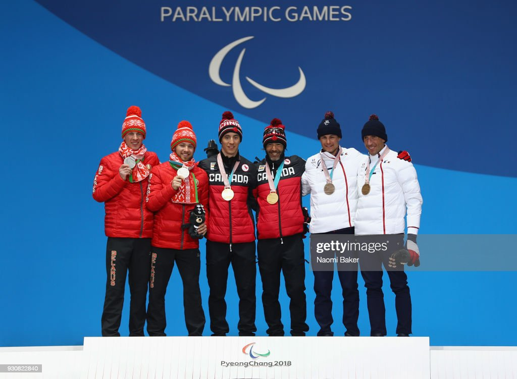 Silver medalists Yury Holub and his guide Dzmitry Budzilovich of Belarus, Gold medalists Brian McKeever and his guide Graham Nishikawa of Canada and Bronze Medalists Thomas Clarion and his guide Antoine Bollet of France pose during the victory ceremony for the Men's 20km free, visually impaired cross-country skiing during day three of the PyeongChang 2018 Paralympic Games on March 12, 2018 in Pyeongchang-gun, South Korea.