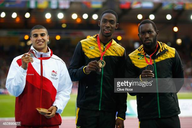 Silver medallist Adam Gemili of England Gold medallist Kemar BaileyCole of Jamaica and bronze medallist Nickel Ashmeade of Jamaica pose on the podium...