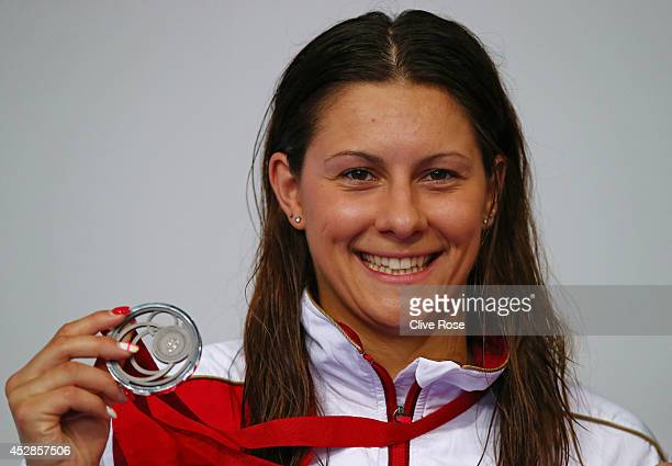 Silver medallist Aimee Willmott of England poses during the medal ceremony for the Women's 200m Butterfly Final at Tollcross International Swimming...
