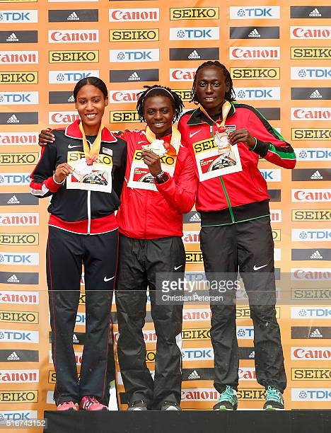 Silver medallist Ajee Wilson of the United States gold medallist Francine Niyonsaba of Burundi and Margaret Nyairera Wambui of Kenya during the medal...