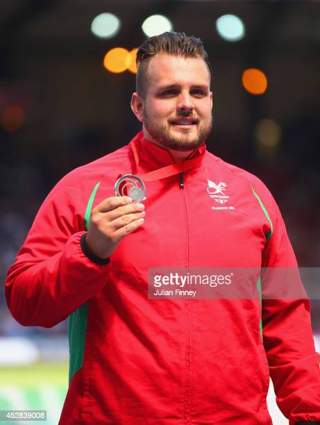 Silver medallist Aled Davies of Wales on the podium during the medal ceremony for the Men's F42/44 Discus at Hampden Park during day five of the...