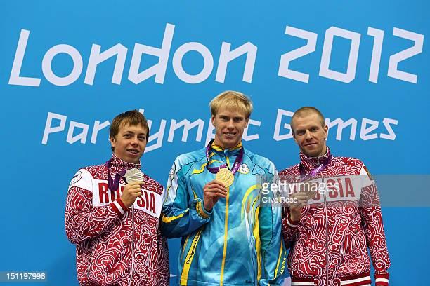 Silver medallist Aleksandr NevolinSvetov of Russia gold medallist Maksym Veraksa of Ukraine and bronze medallist Sergey Punko Russia pose on the...
