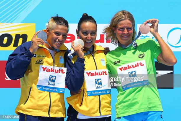 Silver medallist Ana Marcela Cunha of Brazil gold medallist Poliana Okimoto of Brazil and bronze medallist Angela Alexandra Maurer celebrate after...