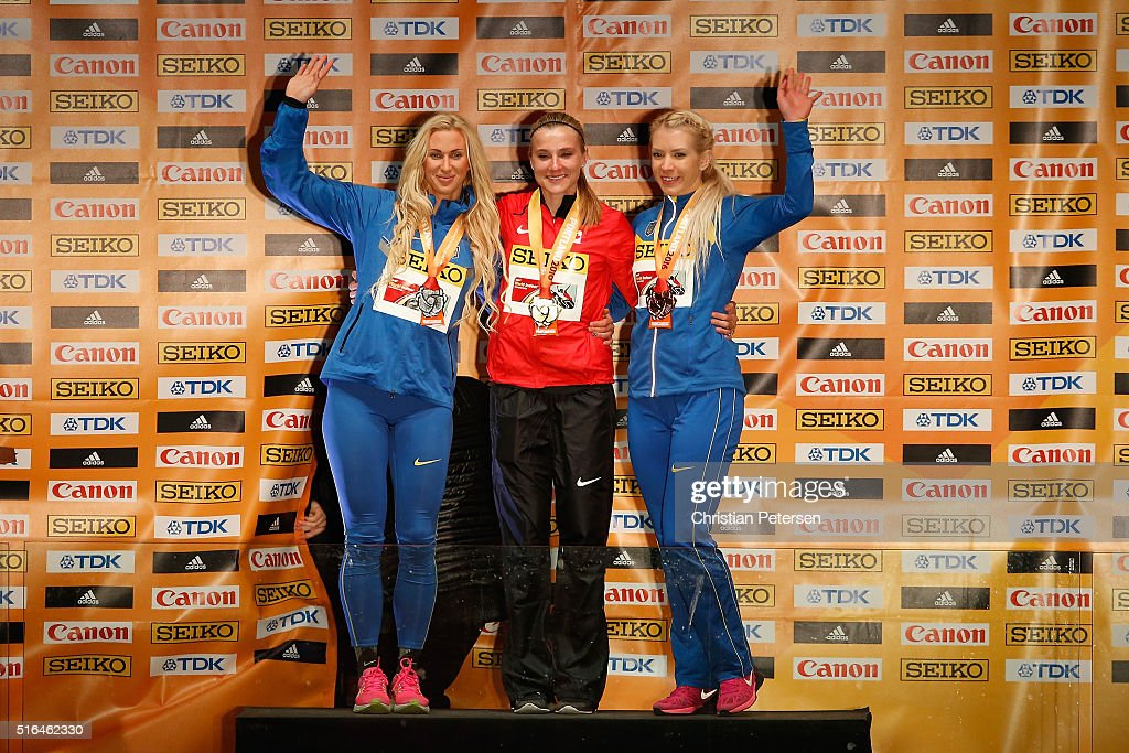 Silver medallist Anastasiya Mokhnyuk of Ukraine, gold medallist Brianne Theisen Eaton of Canada and bronze medallist Alina Fodorova of Ukraine pose on the podium during the medal ceremony for the Women's Pentathlon during day two of the IAAF World Indoor Championships at Pioneer Courthouse Square on March 18, 2016 in Portland, Oregon.