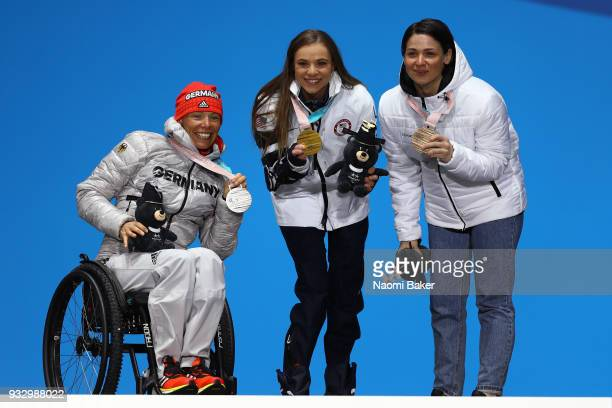 Silver Medallist Andrea Eskau of Germany Gold Medallist Oksana Masters of the United States and Bronze Medallist Marta Zainullina of Neutral...
