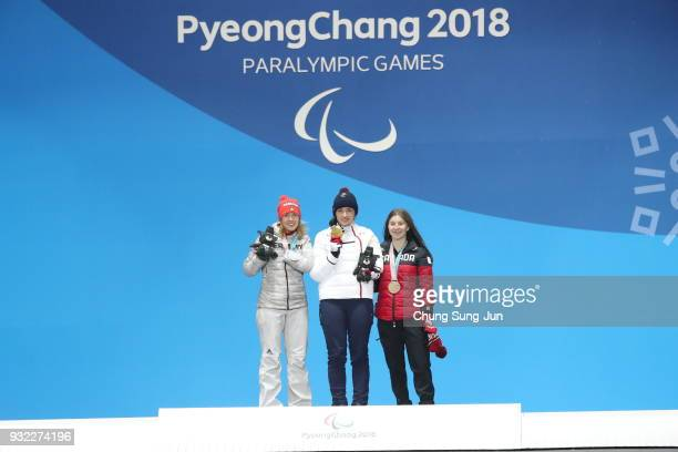 Silver medallist Andrea Rothfuss of Germany Gold medallist Marie Bochet of France and Bronze medallist Mollie Jepsen of Canada celebrate on the...
