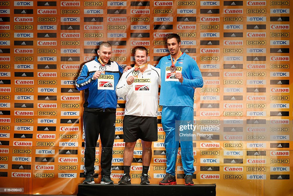 Silver medallist Andrei Gag of Romania, gold medallist Tomas Walsh of New Zealand and bronze medallist Filip Mihaljevic of Croatia pose on the podium during the medal ceremony for the Men's Shot Put at Pioneer Courthouse Square on March 18, 2016 in Portland, Oregon.