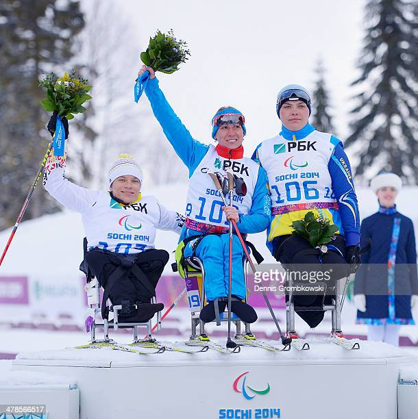 Silver medallist Anja Wicker of Germany gold medallist Svetlana Konovalova of Russia and bronze medallist Olena Iurkovska of Ukraine pose at the...