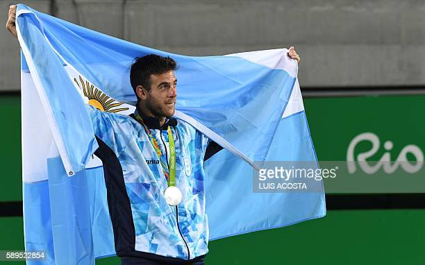 Silver medallist Argentina's Juan Martin Del Potro poses during the podium ceremony of the men's singles gold medal tennis event at the Olympic...