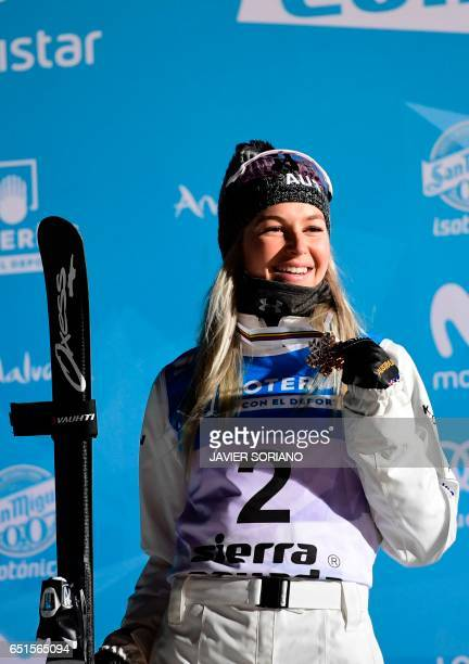 Silver medallist Australian skier Danielle Scott poses on the podium of the women's aerials final in the FIS Snowboard and Freestyle Ski World...