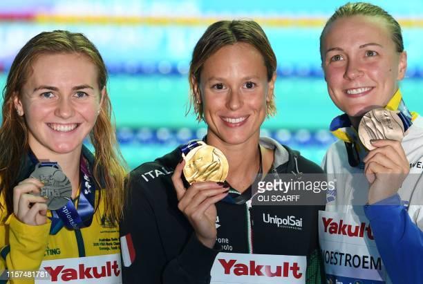 Silver medallist Australia's Ariarne Titmus gold medallist Italy's Federica Pellegrini and bronze medallist Sweden's Sarah Sjoestroem pose with their...