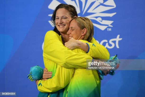 Silver medallist Australia's Cate Campbell hugs gold medallist Australia's Bronte Campbell after the swimming women's 100m freestyle final during the...