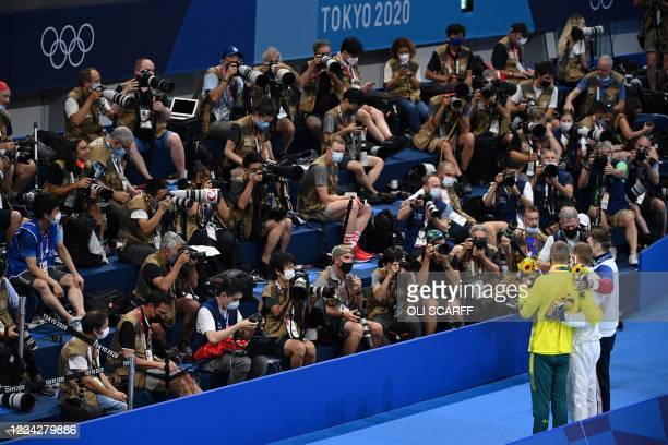 Silver medallist Australia's Kyle Chalmers , Gold medallist USA's Caeleb Dressel and Russia's Kliment Kolesnikov pose for photographers after the...