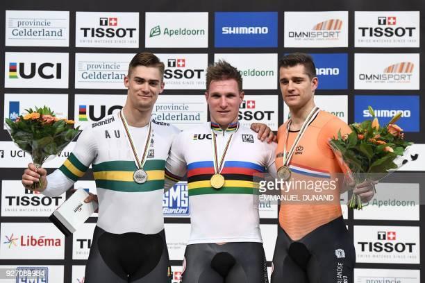silver medallist Australia's Matthew Glaetzer gold medallist Netherland's Jeffrey Hoogl and bronze medallist Netherland's Theo Bos pose on the podium...