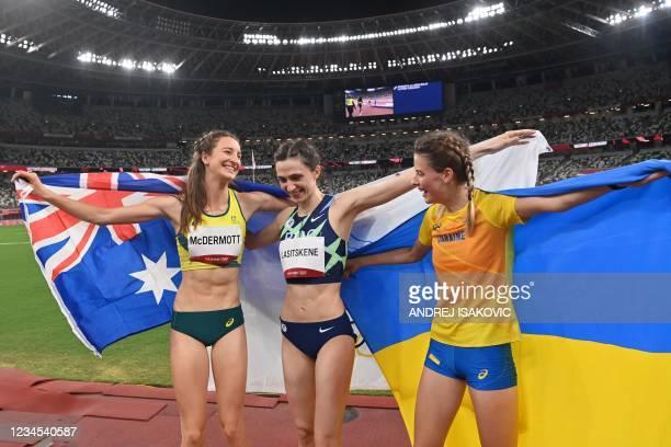 Silver medallist Australia's Nicola McDermott, gold medallist Russia's Mariya Lasitskene and bronze medallist Ukraine's Yaroslava Mahuchikh celebrate...