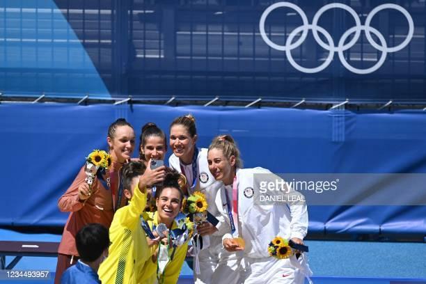 Silver medallist Australia's Taliqua Clancy takes a selfie with bronze medallists Switzerland's Anouk Verge-Depre and Joana Heidrich and gold...