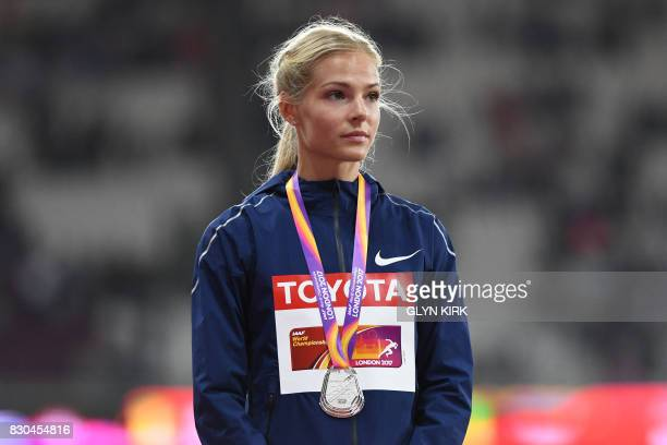 Silver medallist Authorised Neutral Athlete Darya Klishina poses on the podium during the victory ceremony for the women's long jump athletics event...