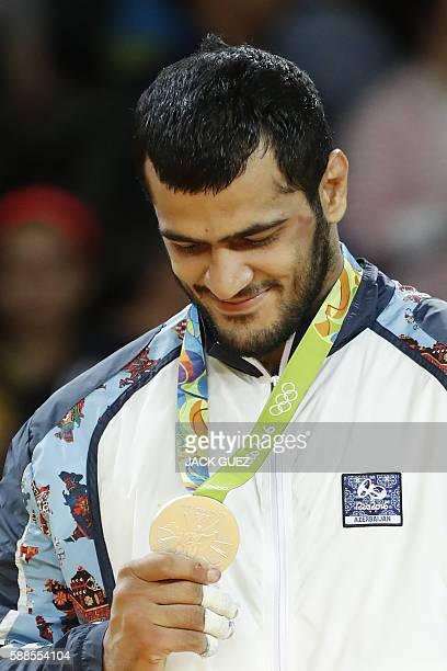 Silver medallist Azerbaijan's Elmar Gasimov celebrates on the podium of the men's 100kg judo contest of the Rio 2016 Olympic Games in Rio de Janeiro...