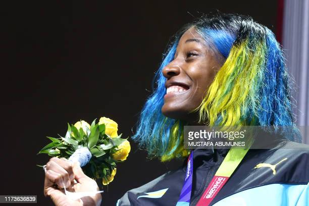 Silver medallist Bahamas' Shaunae Miller-Uibo poses on the podium during the medal ceremony for the Women's 400m at the 2019 IAAF World Athletics...