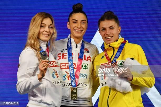 Silver medallist Belarus' Nastassia MironchykIvanova gold medallist Serbia's Ivana Spanovic and bronze medallist Ukraine's Maryna BekhRomanchuk pose...