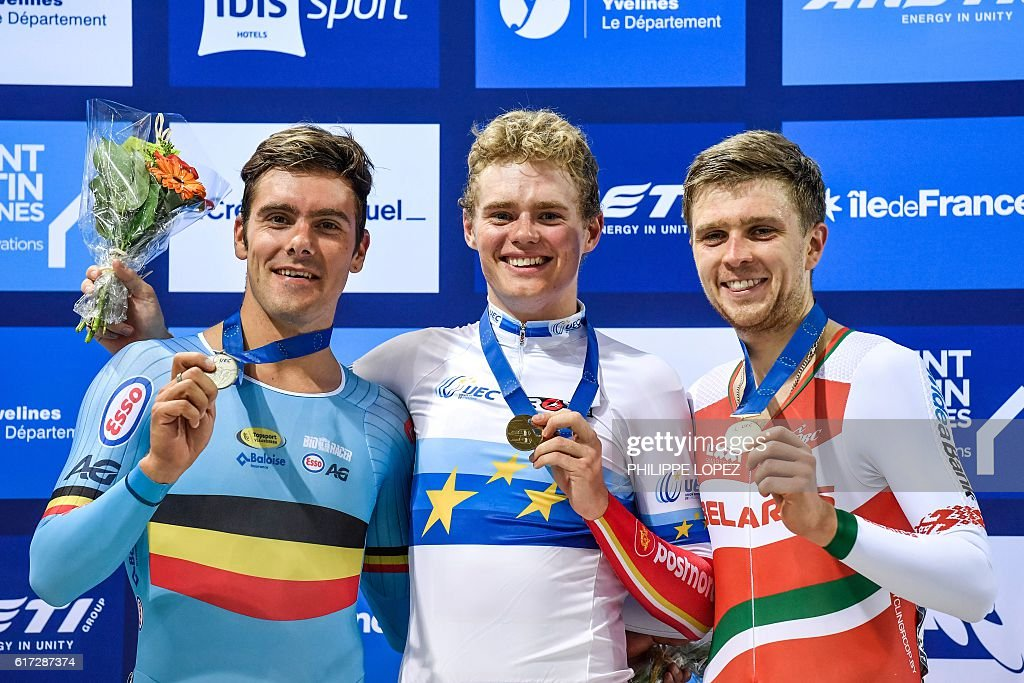 Silver medallist Belgian cyclist Kenny De Ketele, gold medallist Danish cyclist Niklas Larsen and bronze medallist Belarussian Raman Ramanau stand on the podium of the points race at the European Track Championships Saint Quentin en Yvelines on October 22, 2016. / AFP / PHILIPPE