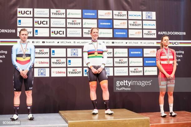 Silver medallist Belgium's Jolien D'Hoore gold medallist Netherland's Kirsten Wild and bronze medallist Denmark's Amalie Dideriksen celebrate on the...