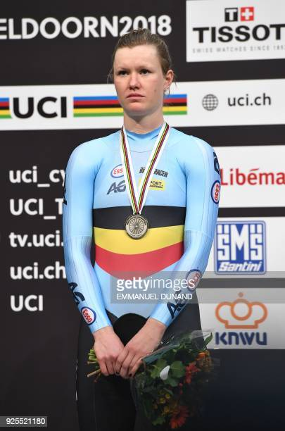 Silver medallist Belgium's Jolien D'Hoore poses on the podium after the women's scratch race at The UCI World Cycling Championships in Apeldoorn on...
