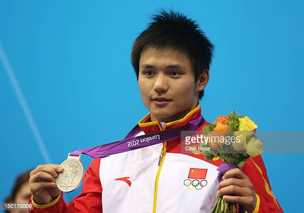 Silver medallist Bo Qui of China celebrates on the podium during the medal ceremony for the Men's 10m Platform Diving Semifinal on Day 15 of the...