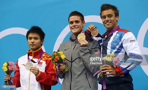 Silver medallist Bo Qui of China gold medallist David Boudia of the United States and bronze medallist Tom Daley of Great Britain pose on the podium...