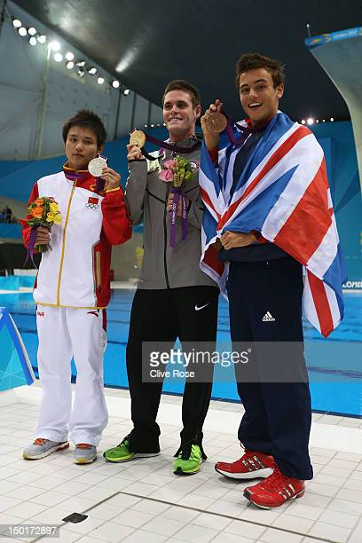 Silver medallist Bo Qui of China gold medallist David Boudia of the United States and bronze medallist Tom Daley of Great Britain pose after the...