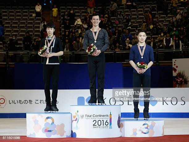 Silver medallist Boyang Jin of China Gold medallist Patrick Chan of Canada and Bronze medallist Han Yan of China stand on the podium of the Men's...