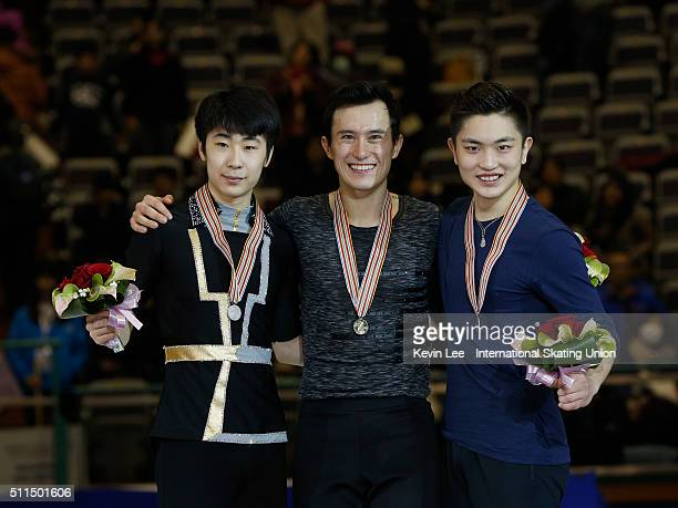 Silver medallist Boyang Jin of China Gold medallist Patrick Chan of Canada and Bronze medallist Han Yan of China pose for a picture on the podium of...