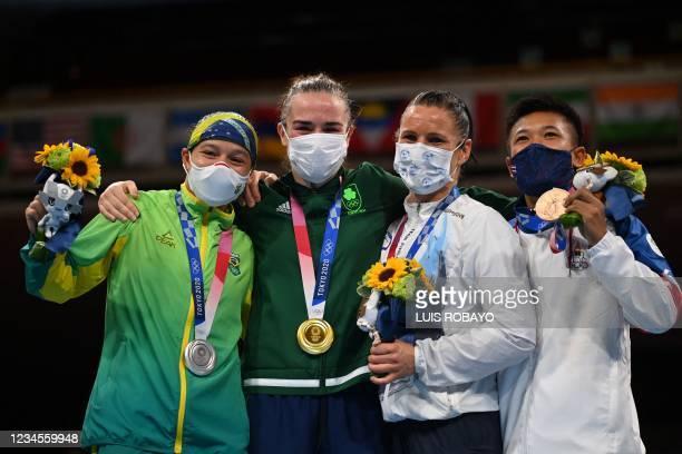 Silver medallist Brazil's Beatriz Ferreira, gold medallist Ireland's Kellie Anne Harrington, bronze medallists Finland's Mira Marjut Johanna Potkonen...