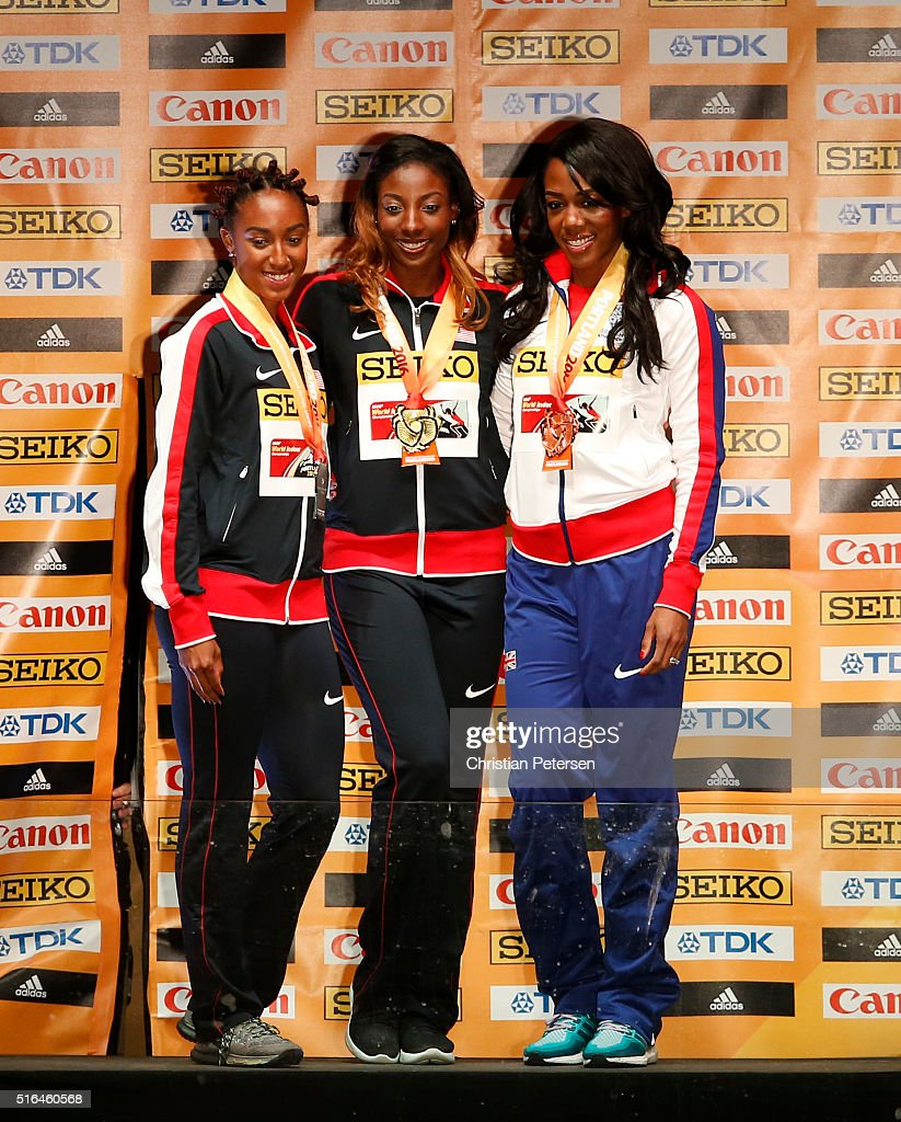 Silver medallist Brianna Rollins of the United States, gold medallist Nia Ali of the United States and bronze medallist Tiffany Porter of Great Britain pose on the podium during the medal ceremony for the Women's 60 metres hurdles during day two of the IAAF World Indoor Championships at Pioneer Courthouse Square on March 18, 2016 in Portland, Oregon.
