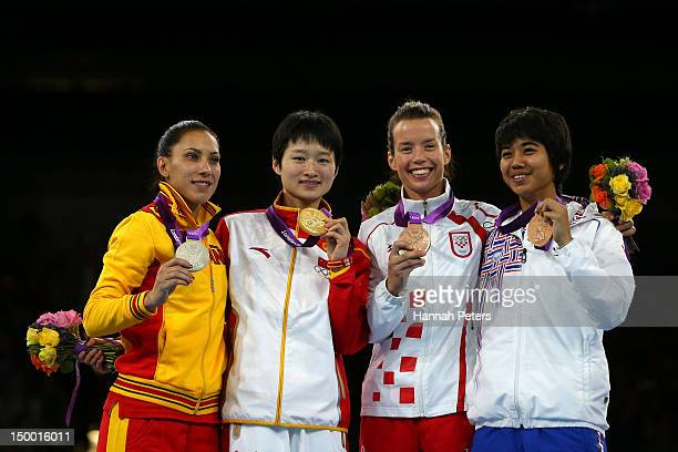 R Silver medallist Brigitte Yague Enrique of Spain gold medallist Jingyu Wu of China bronze medallist Lucija Zanniovic of Croatia and bronze...